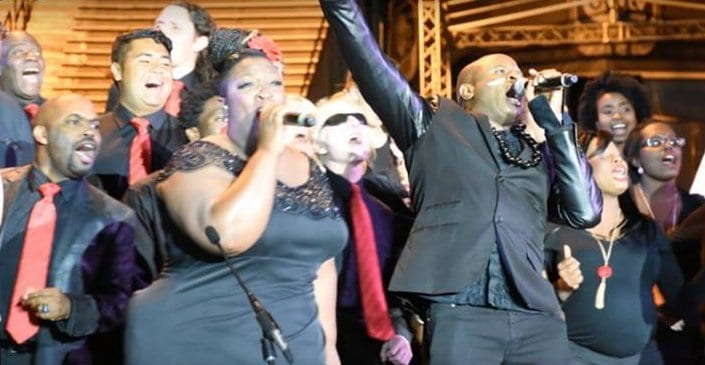 Alex Boye performs with the Unity Gospel Choir at Stadium of Fire. Image: Unity Gospel Choir Facebook page (click on the image to visit)